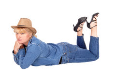 Woman lying on floor with cowboy hat. Stock Photos