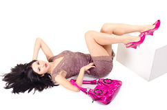 Woman lying on the floor with disheveled hair. And keeps on hand bag Stock Images