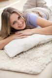 Woman lying on the floor indoors Royalty Free Stock Photo