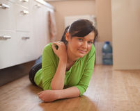 Woman lying on the floor in kitchen Royalty Free Stock Images