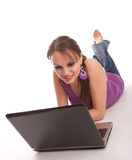Woman lying on the floor with laptop Stock Images
