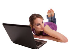 Woman lying on the floor with laptop stock photo