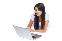 Woman lying on the floor with laptop Royalty Free Stock Image