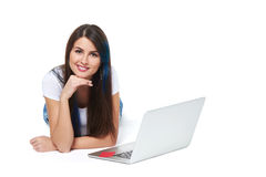 Woman lying on the floor with laptop Stock Photography