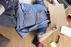 Woman lying on floor with mobile phone, notebook and laptop. Woman lying on wooden floor with mobile phone, notebook and laptop Stock Image