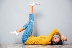 Woman lying on the floor with raised legs up Stock Photos