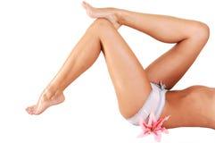 Woman lying on floor shooing her legs. Stock Photography