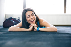 Woman lying on the floor and showing her tongue Royalty Free Stock Photography