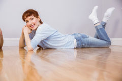 Woman lying on the floor Stock Photography