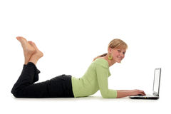 Woman lying on floor using laptop Stock Photography