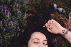 Woman Lying on Flower Field Stock Photography