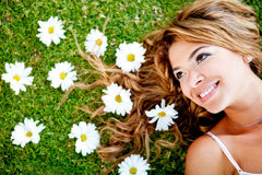 Woman lying on a flower garden Royalty Free Stock Image