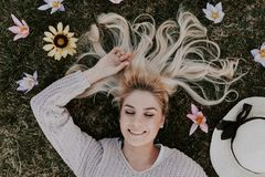 Woman Lying on Flowers Stock Images