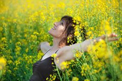 Woman lying in flowers Royalty Free Stock Image