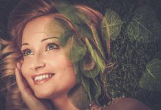 Woman lying on a fresh spring grass Stock Photos