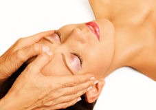 Woman lying, gets massage, reiki,
