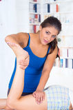 Woman lying while getting a leg massage concept of Stock Image