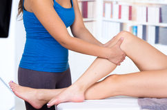 Woman lying while getting a leg massage concept of Stock Photos