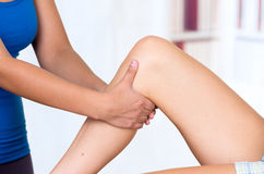 Woman lying while getting a leg massage concept of Stock Photo