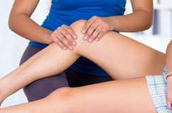 Woman lying while getting a leg massage concept of Stock Photography