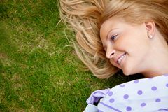 Woman lying on grass Stock Photo
