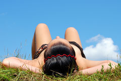 Woman lying on grass Royalty Free Stock Images
