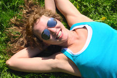 Woman is lying on grass Royalty Free Stock Images
