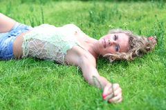 Woman lying on a grass. Nice woman lying on a grass stock images