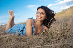 Woman lying in the grass Royalty Free Stock Photos