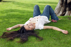 Woman lying on grass Stock Image