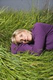 Woman lying in grass Stock Image