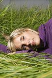 Woman lying in grass stock photos