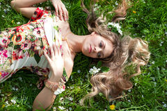 Woman is lying on the grass Stock Photo