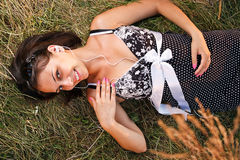 Woman lying on the grass Stock Photography