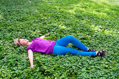 Woman lying on the grass Stock Images