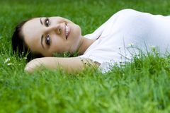 Woman lying on grass Stock Photo
