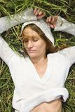 Woman lying in grass. Royalty Free Stock Photos