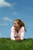 Woman lying on the grass royalty free stock photos
