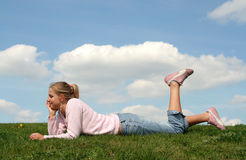 Woman lying on grass royalty free stock photos