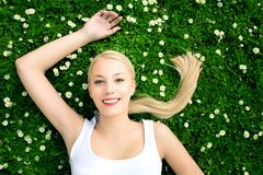 Woman lying on grass Stock Images