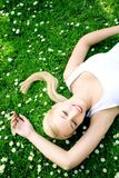 Woman lying on grass Royalty Free Stock Photos