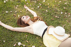Woman lying on the grass. Stock Image
