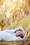 Woman lying in the grass Stock Photo