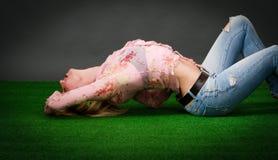 Woman lying on grass Stock Photos
