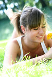 Woman lying on grass, smiling Stock Photography