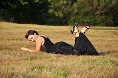 Woman lying in grass Royalty Free Stock Image