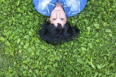 Woman lying on the grass, top view with space for text. Stock Photography