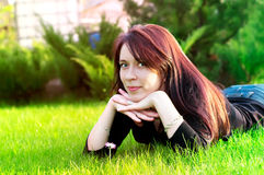 Woman lying on green grass Royalty Free Stock Photo