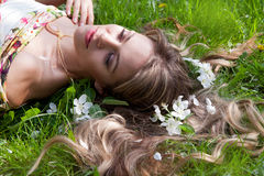 Woman  lying on the green grass Royalty Free Stock Photo