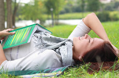 Woman lying on green grass Stock Photos